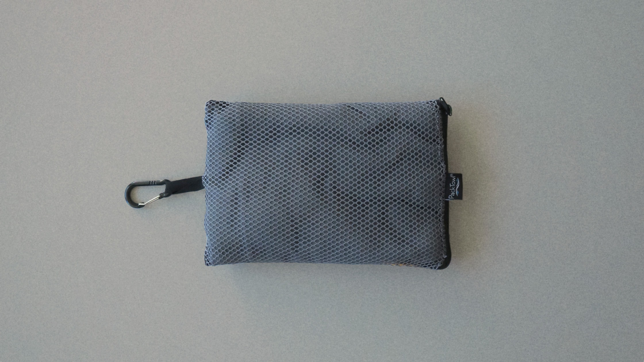 Packtowl Personal inside of its mesh case