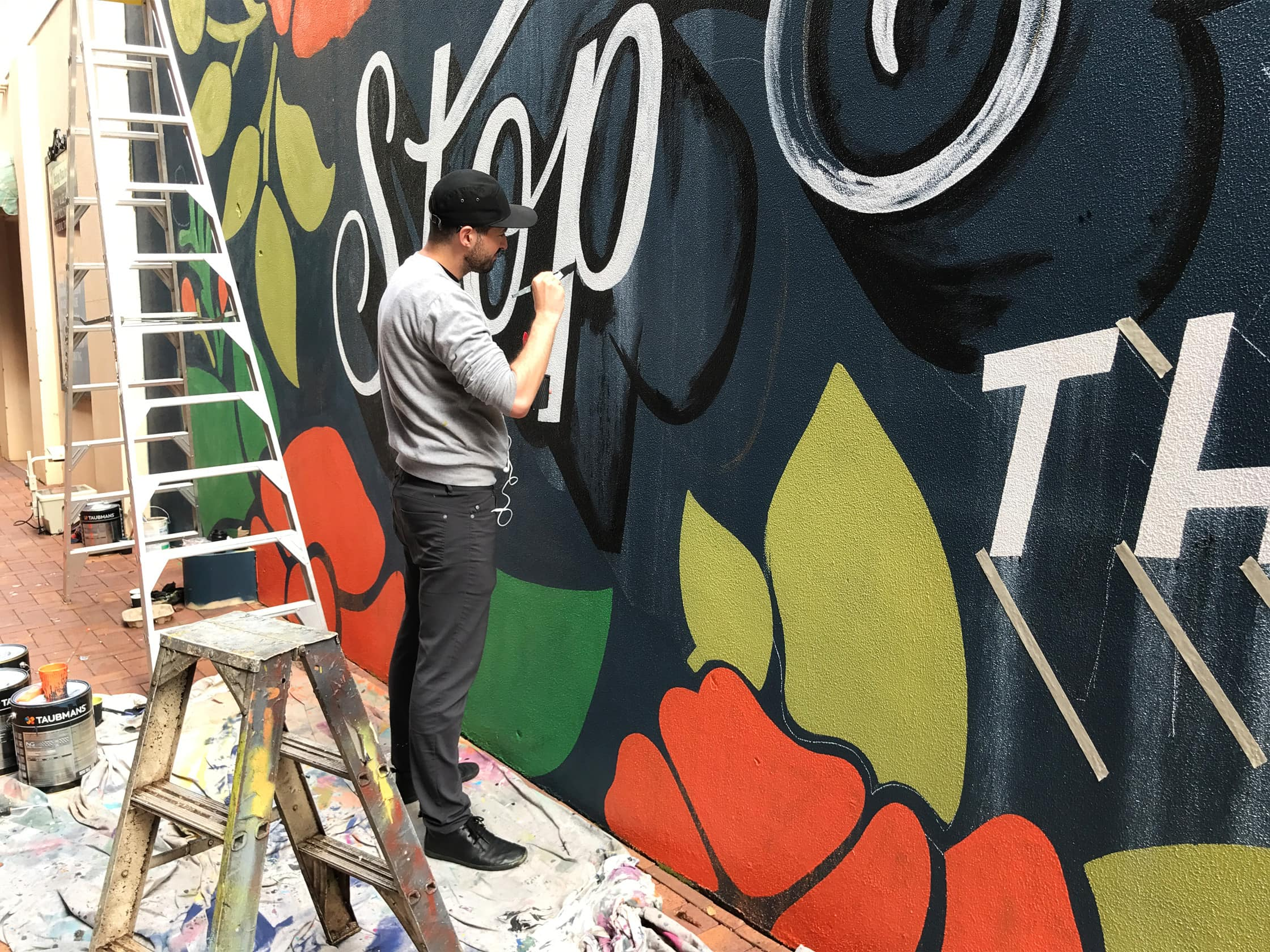 Mural Painting with the Outlier Slim Dungarees in Toowoomba Australia