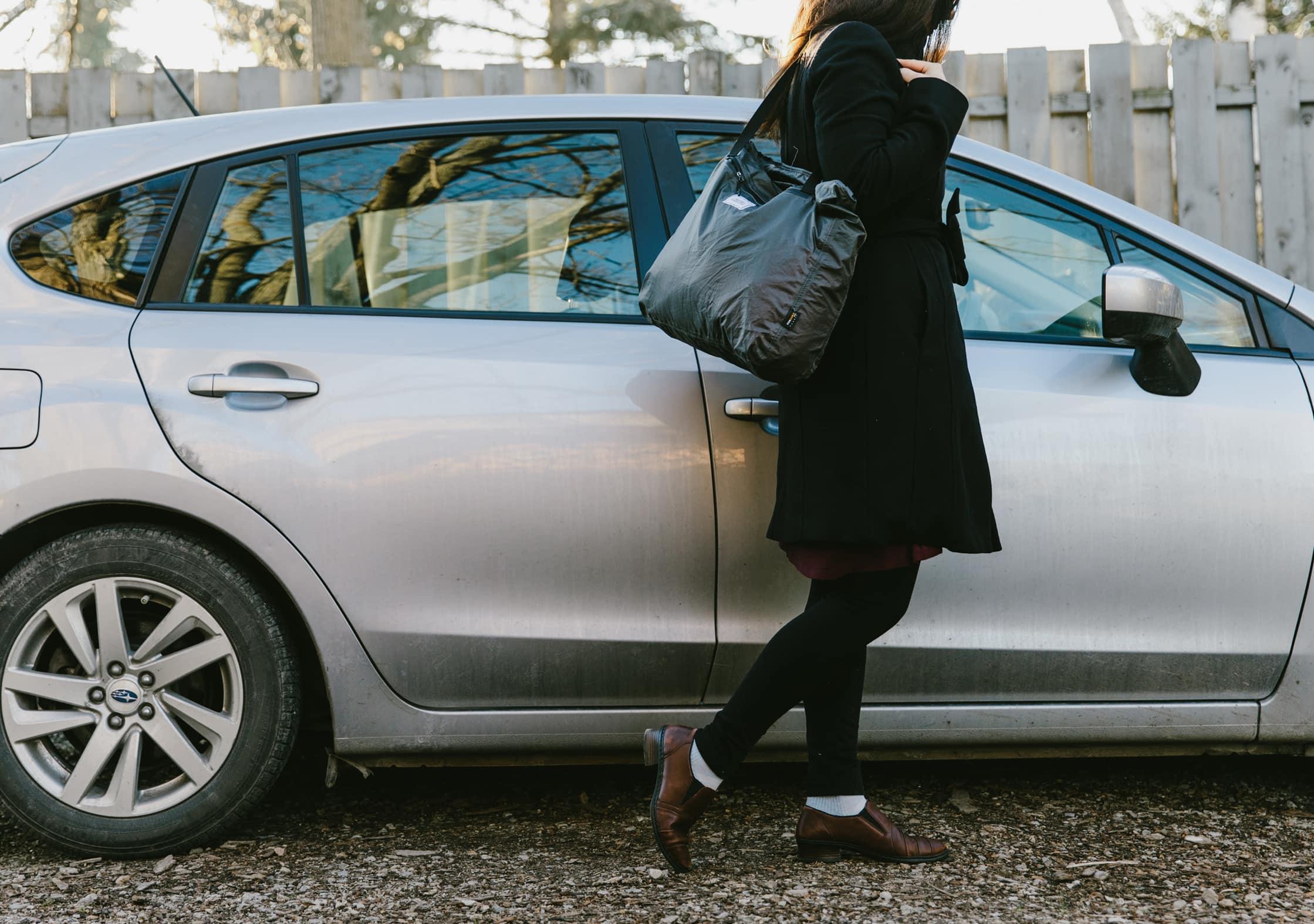 Matador Transit Tote Bag Usage by a Car
