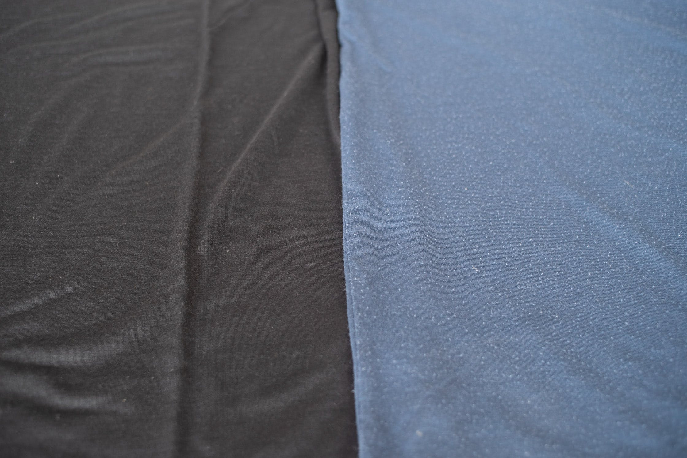 Left: New Runweight Merino T-shirt in Black VS. Right: Used Runweight Merino T-shirt in Sea Blue