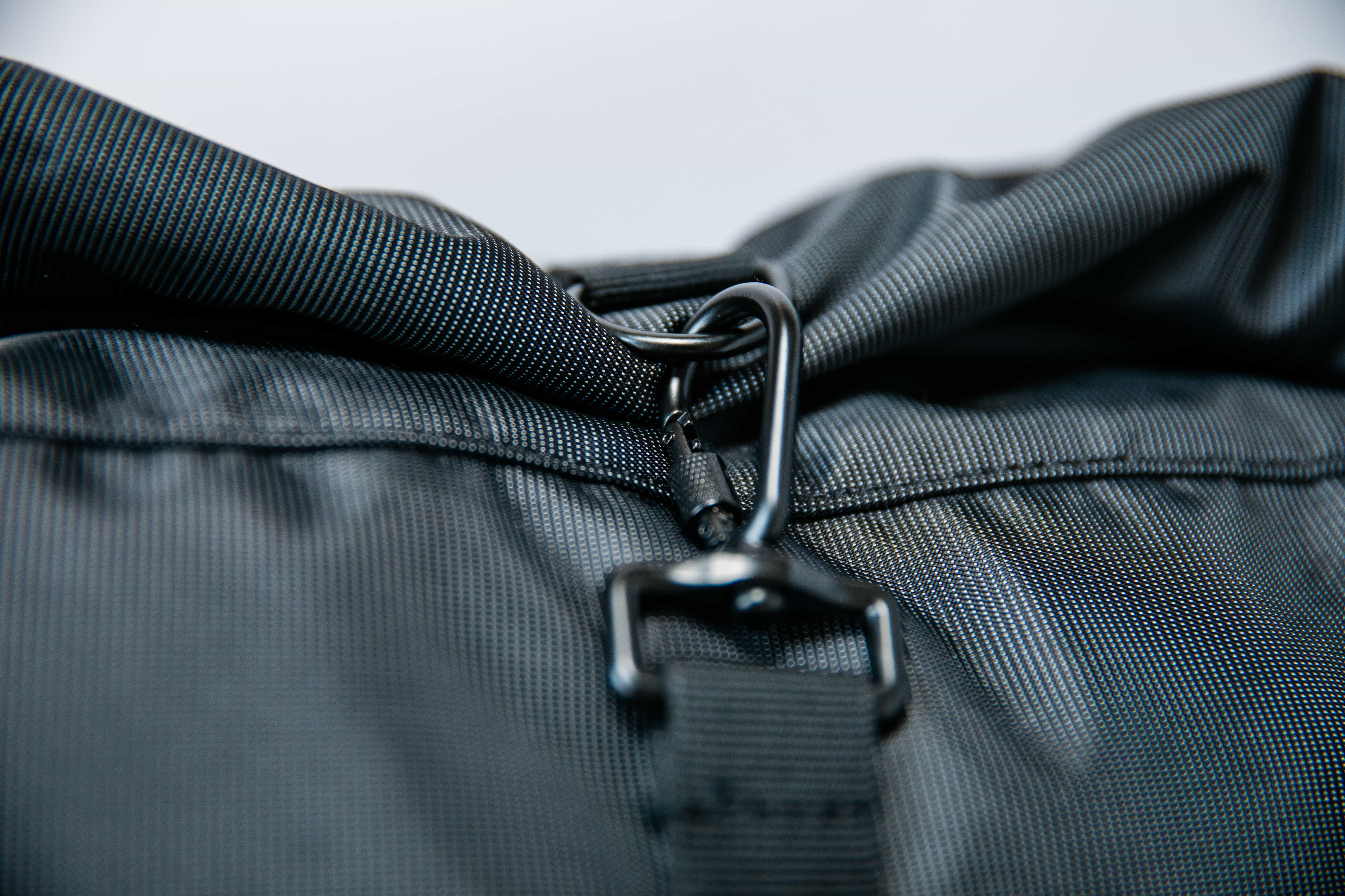 Carabiner closure on roll-top