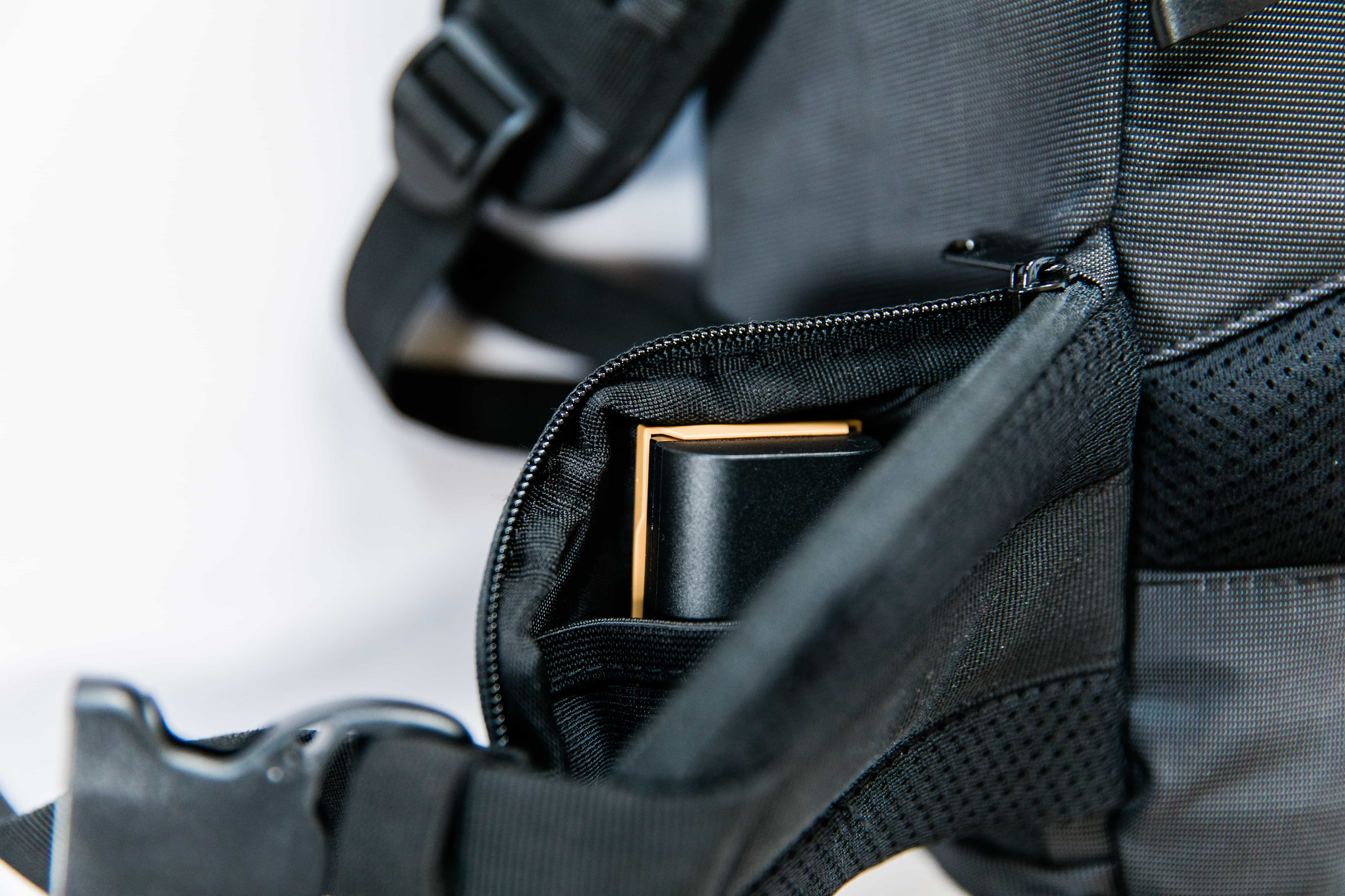 Pockets on the hip straps with Canon battery inside