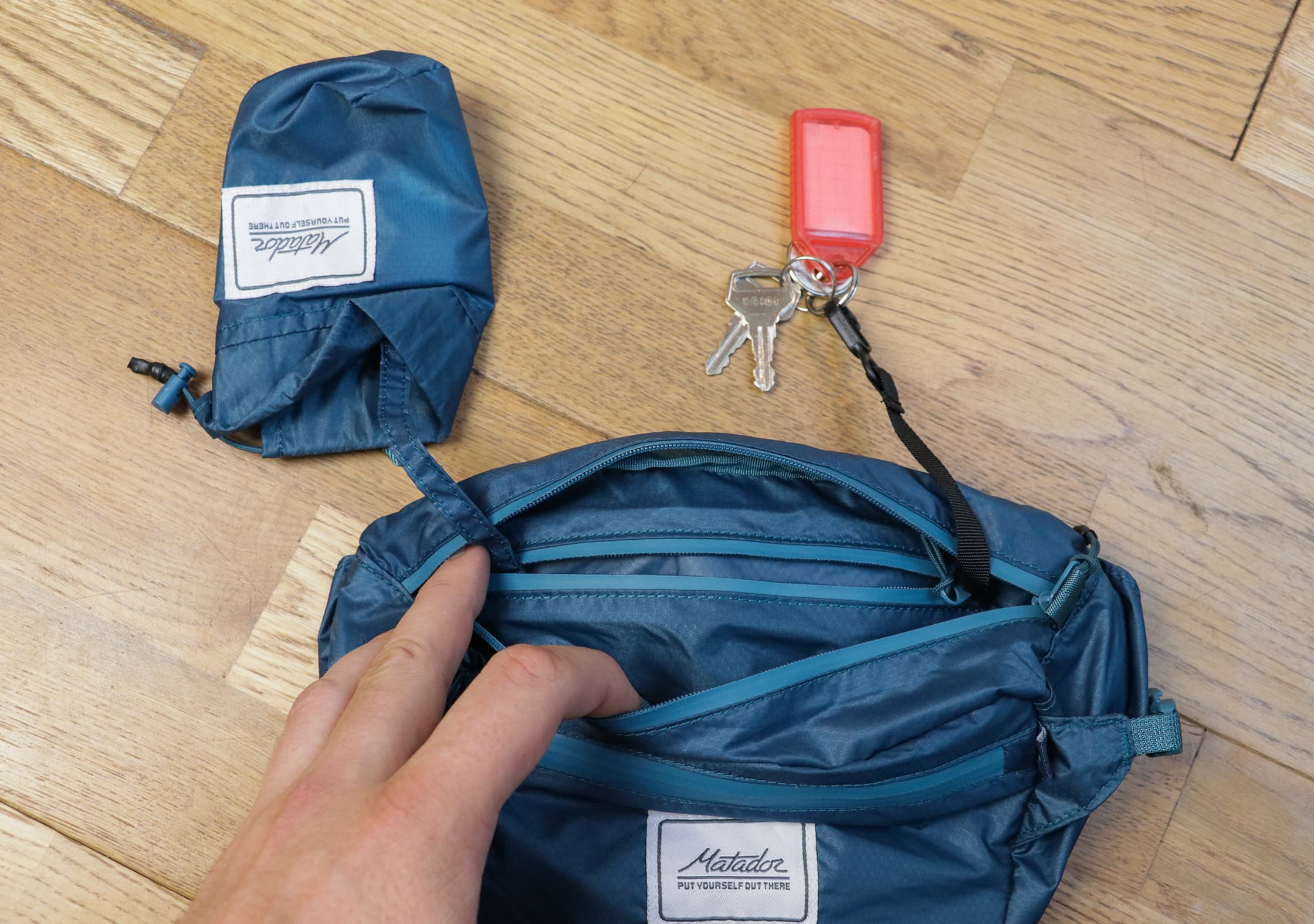 Attached Compression Sack, Internal Compartment, And Key Clip