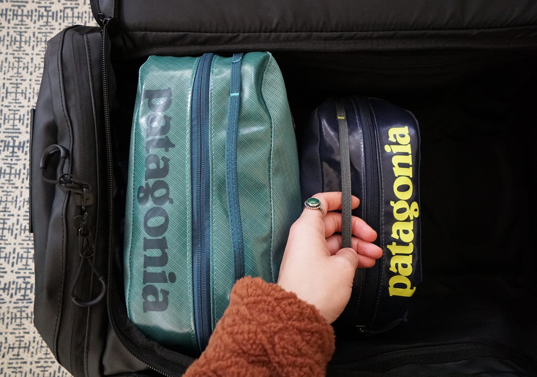 Patagonia Black Hole Cubes Packed into Travel Backpack