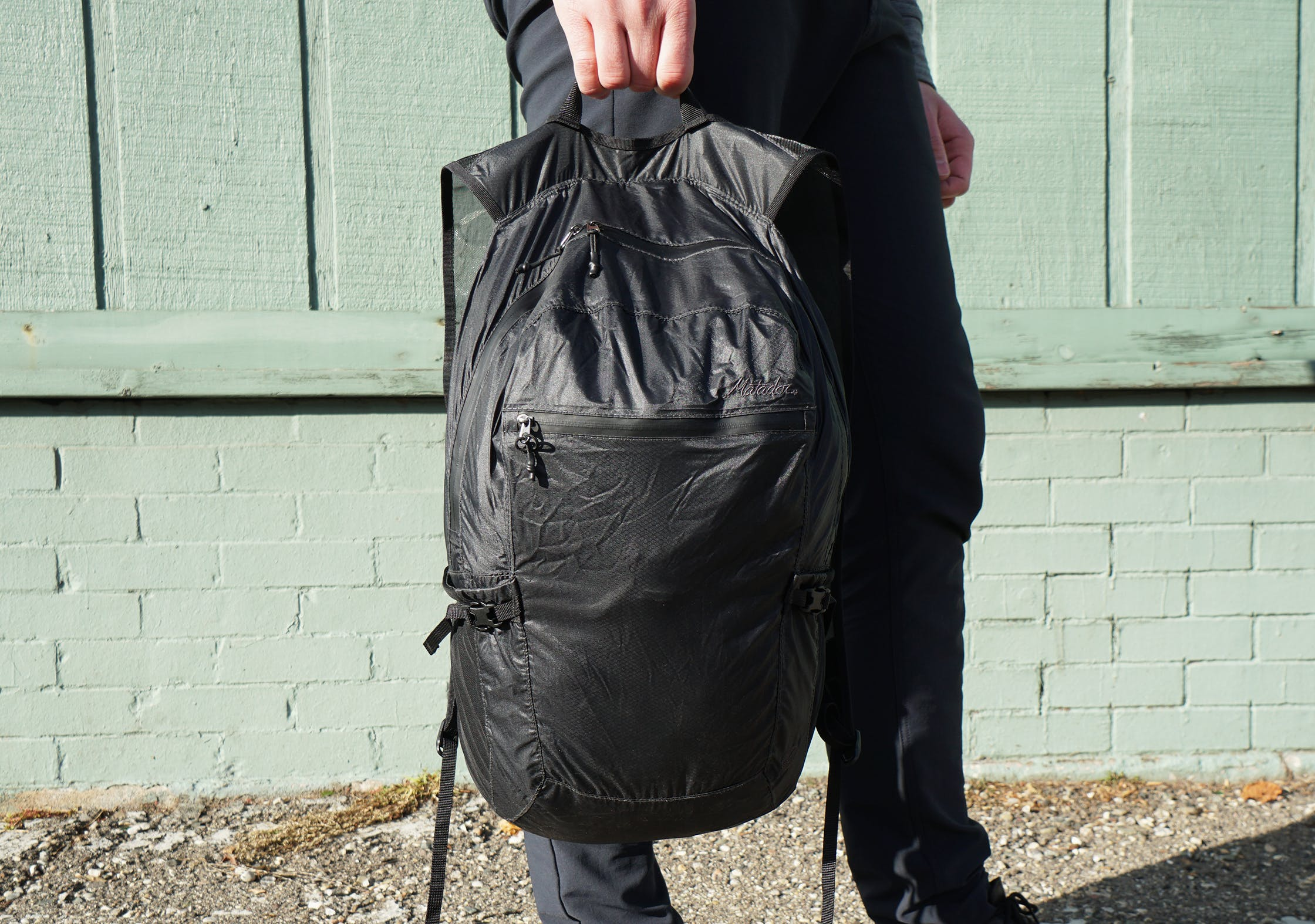 Matador Freefly16 Daypack Held By Top Hook