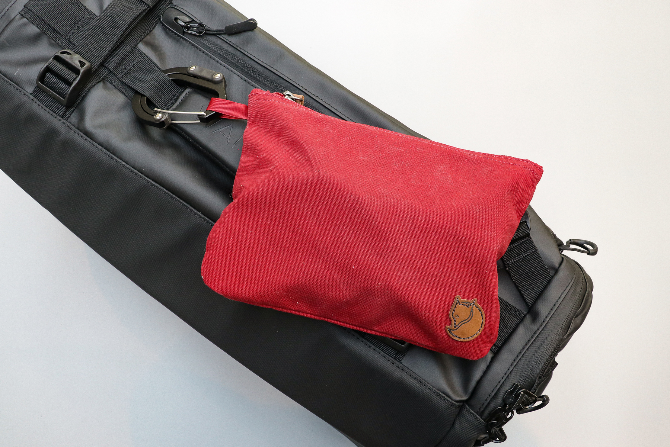 Fjallraven Gear Pocket Attached To The Wandrd Hexad Carryall Duffel With A Heroclip