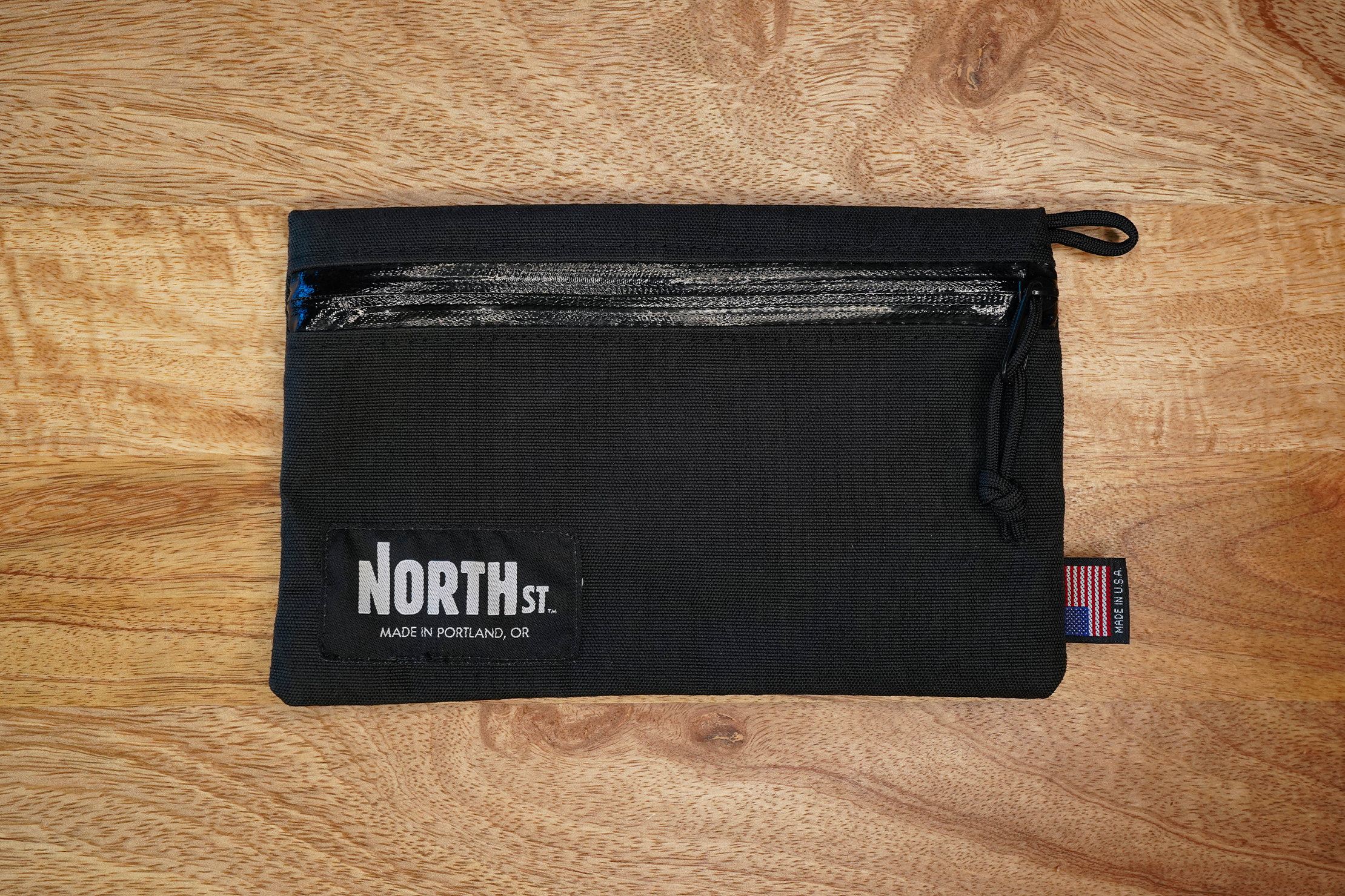 North St. Bags Pittock Travel Pouch On A Desk