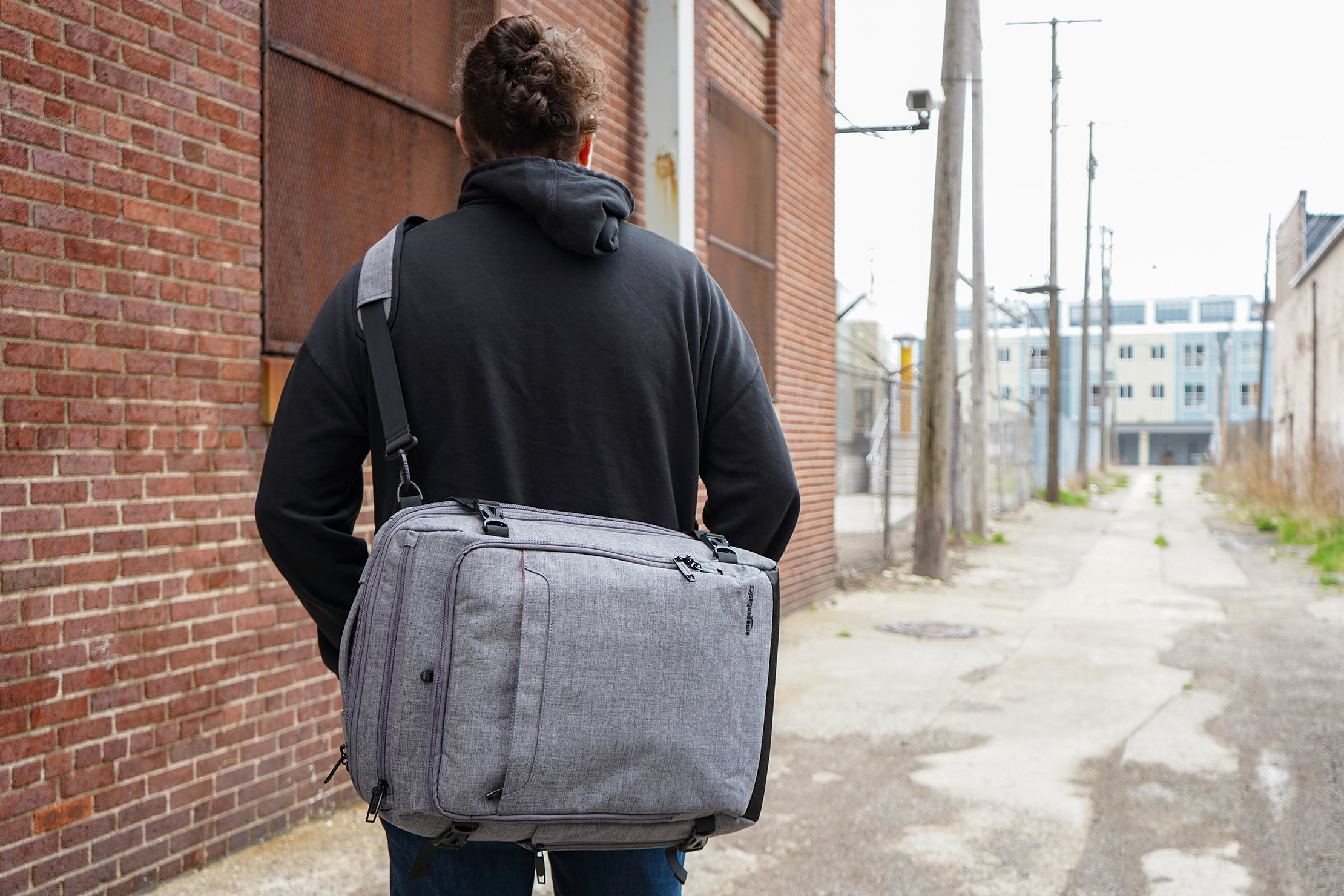 AmazonBasics Slim Travel Backpack Weekender Worn As A Messenger Bag
