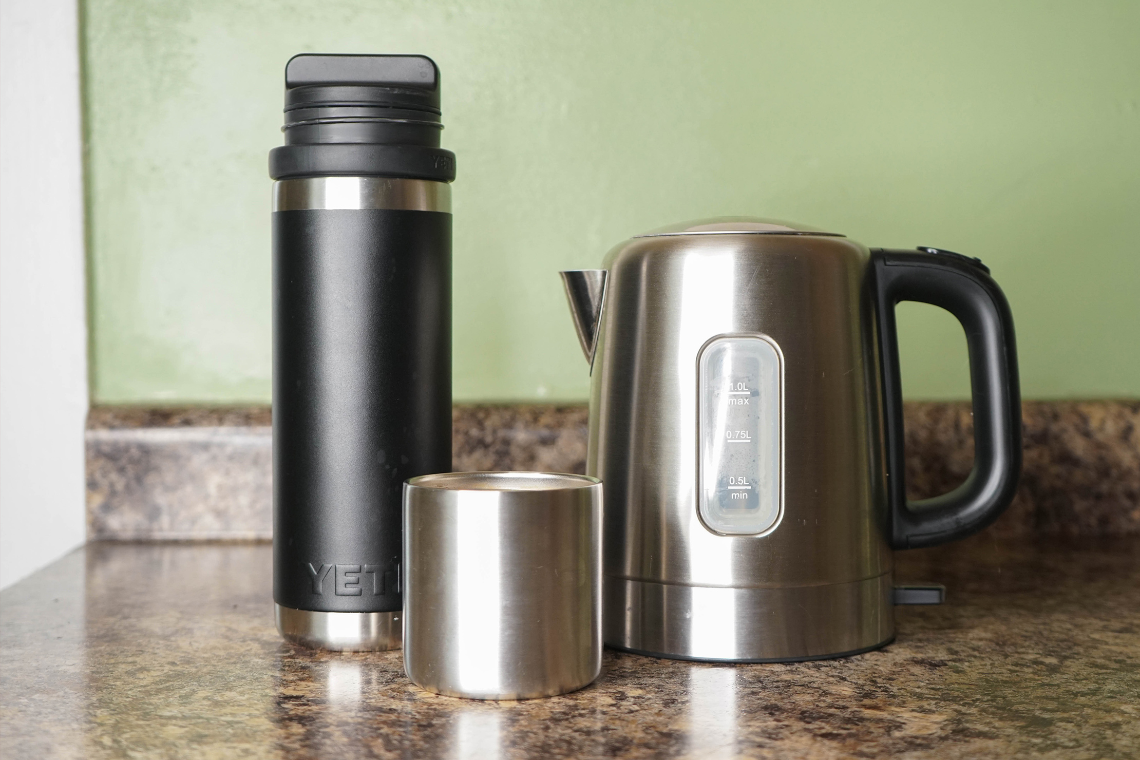 YETI Rambler 18oz Bottle with 5oz Cup Cap Next to Tea Pot