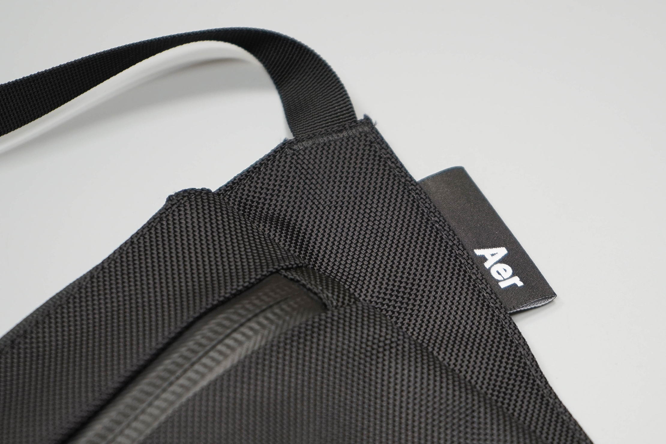 Aer Sling Pouch Logo