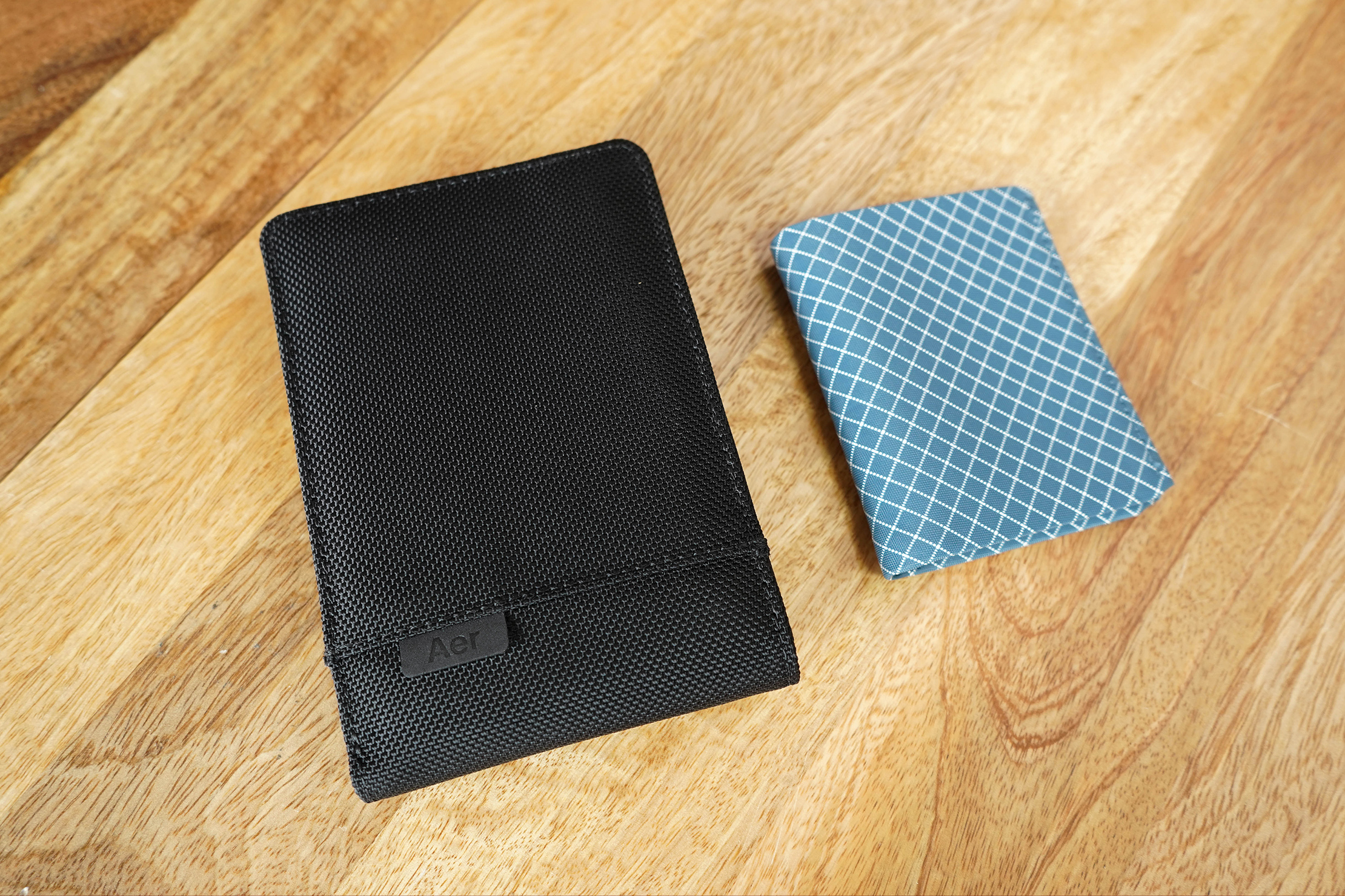Aer Travel Wallet Size Comparison