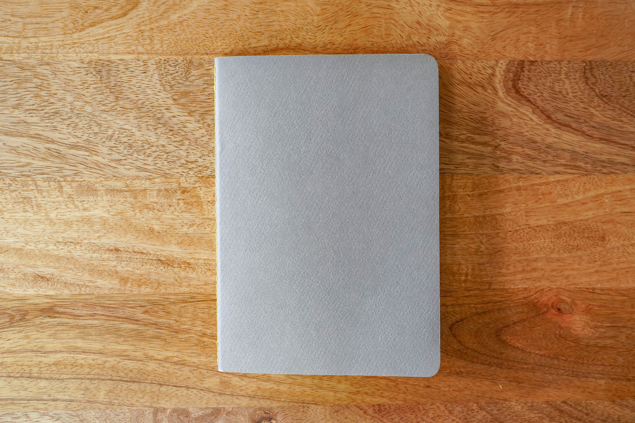Baron Fig Vanguard Softcover Notebook On A Desk