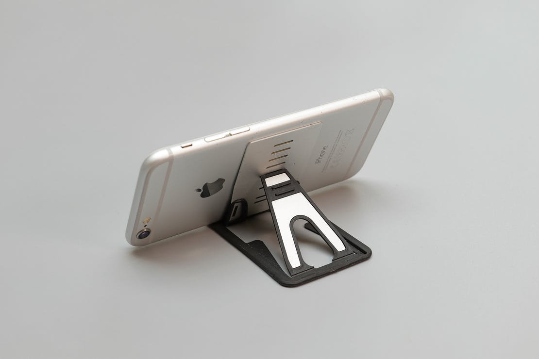 Nite Ize QuikStand Mobile Device Stand Holding An iPhone 6