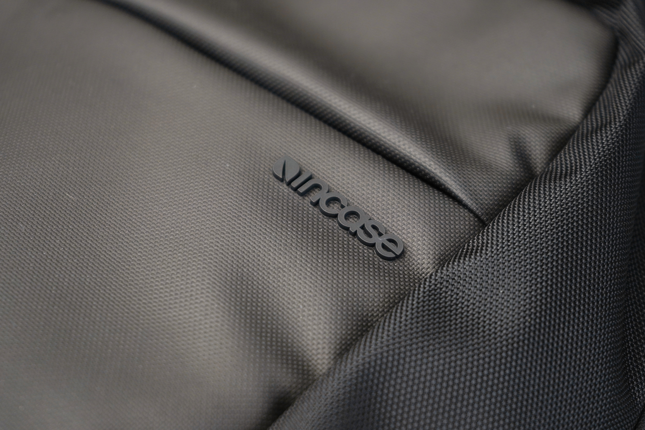 Incase ICON Lite Triple Black Backpack Material and Logo