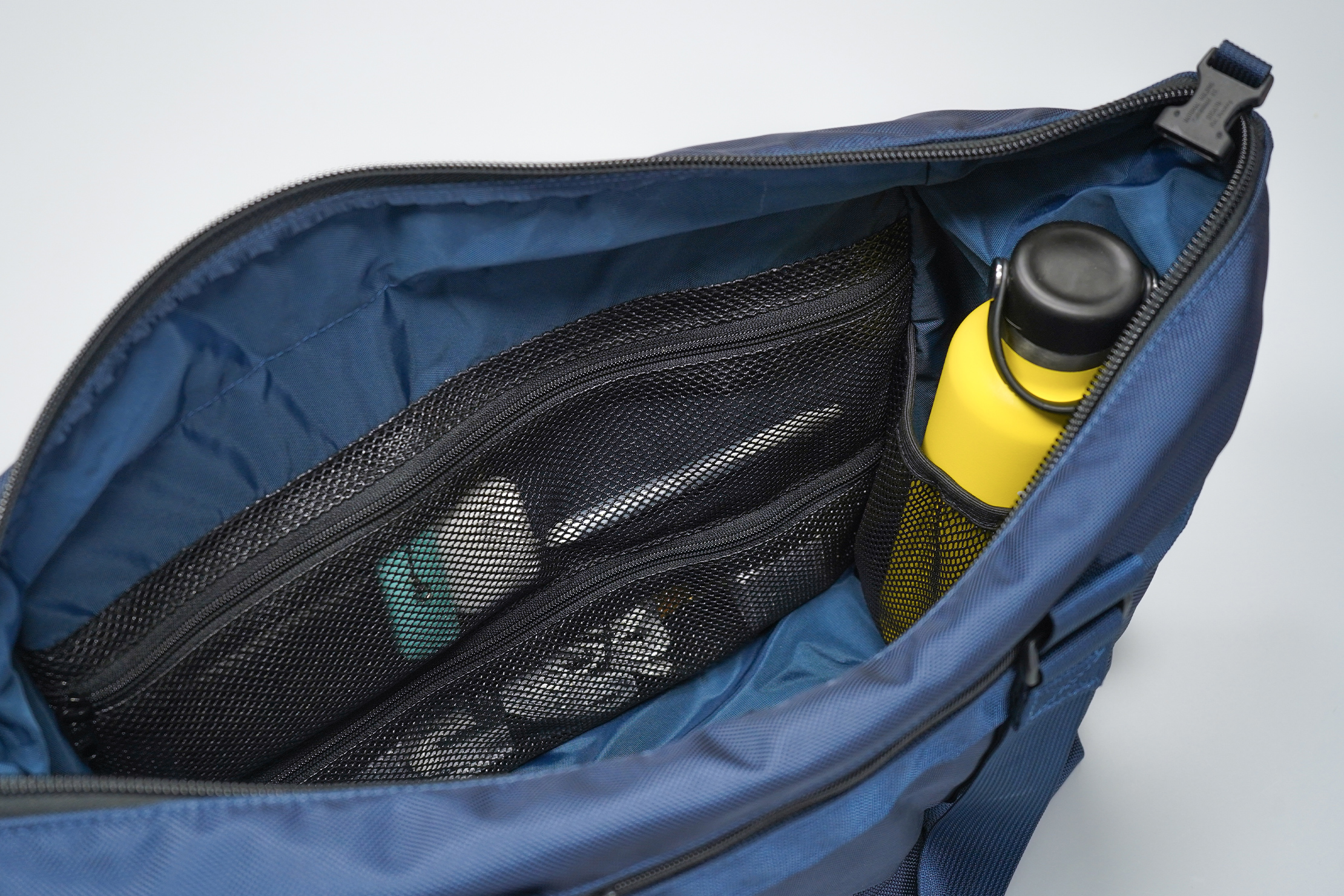 DSPTCH Utility Tote | Small items remain visible yet secure thanks to the mesh material