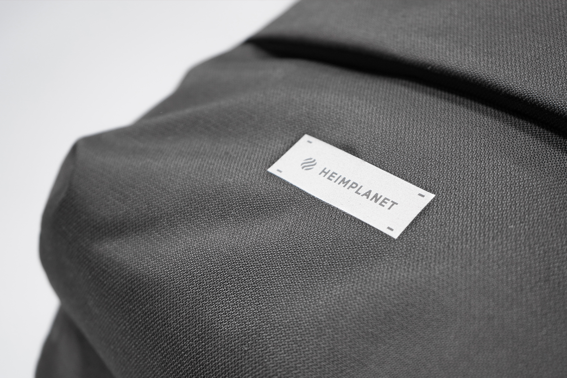 Heimplanet Commuter Pack Material and Logo
