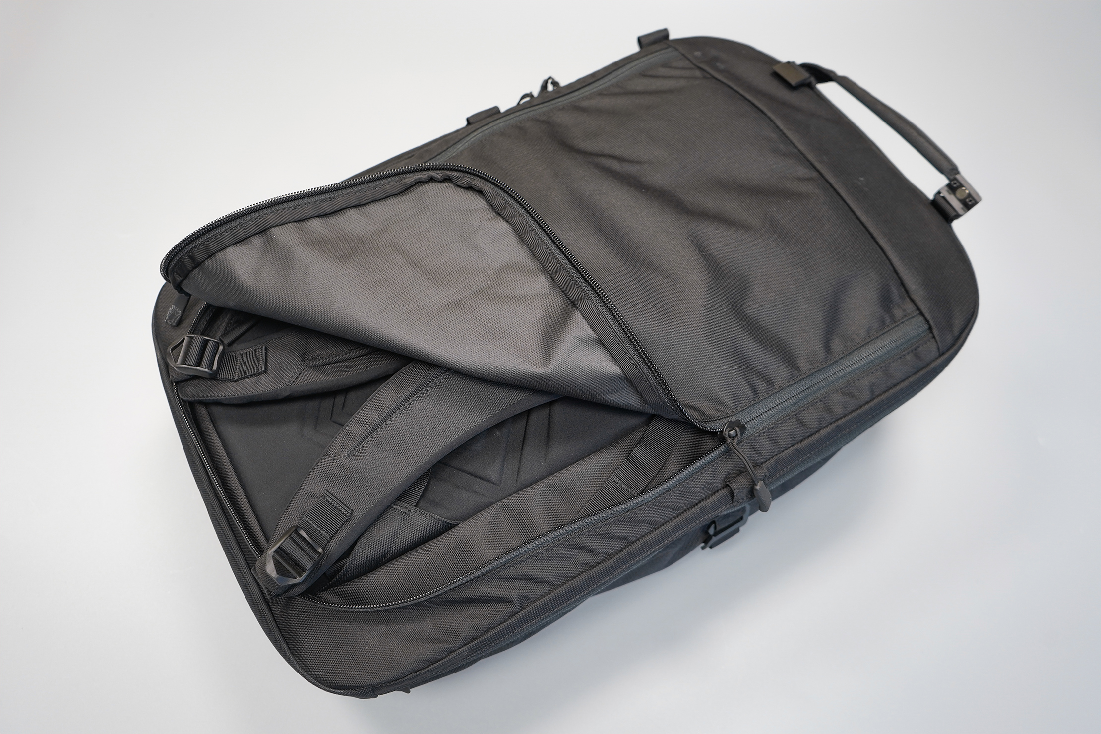 Minaal Carry-On 3.0   Stow the straps away with the roll-up cover