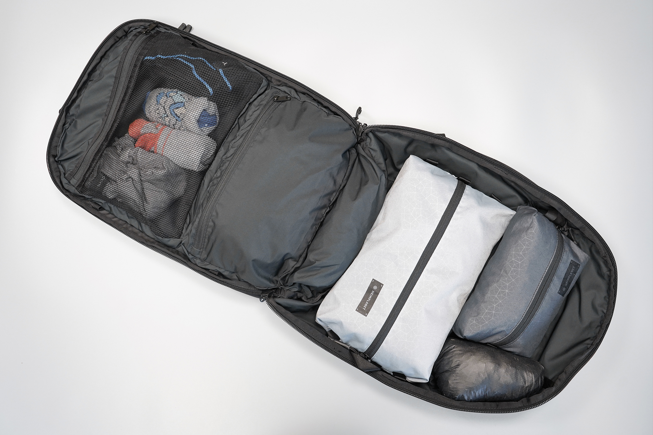 Minaal Carry-On 3.0 | Clamshell-style opening makes scooping up clothes easy