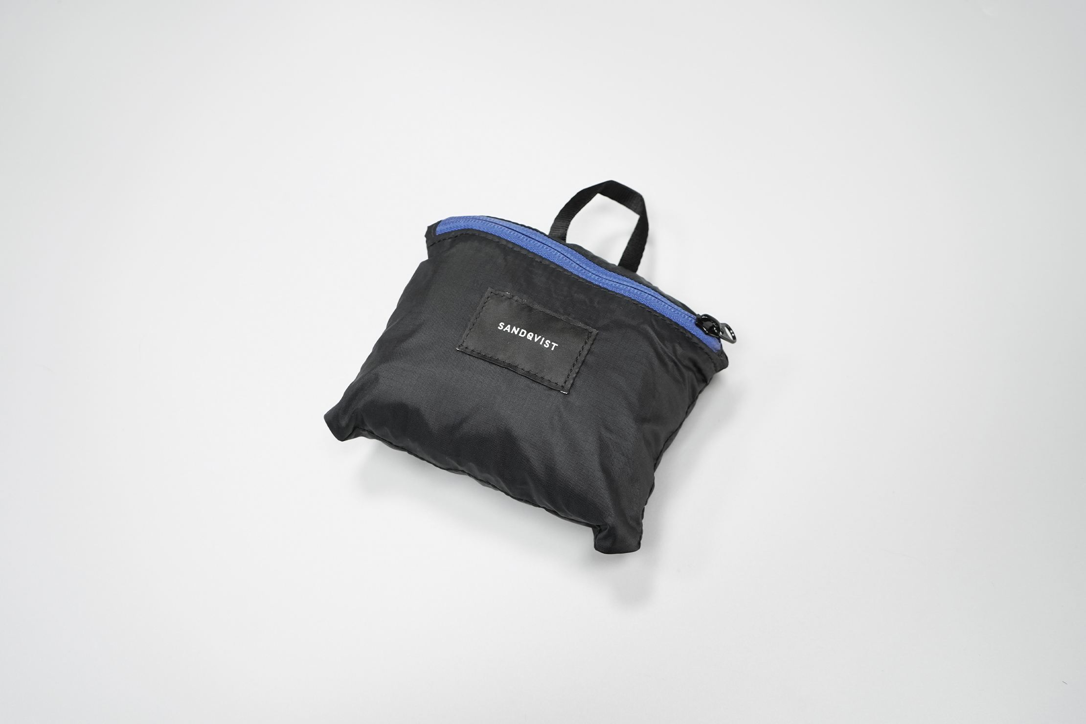 Sandqvist Erland Packable Ziptop Backpack | It compresses down to about half the size of a tech pouch