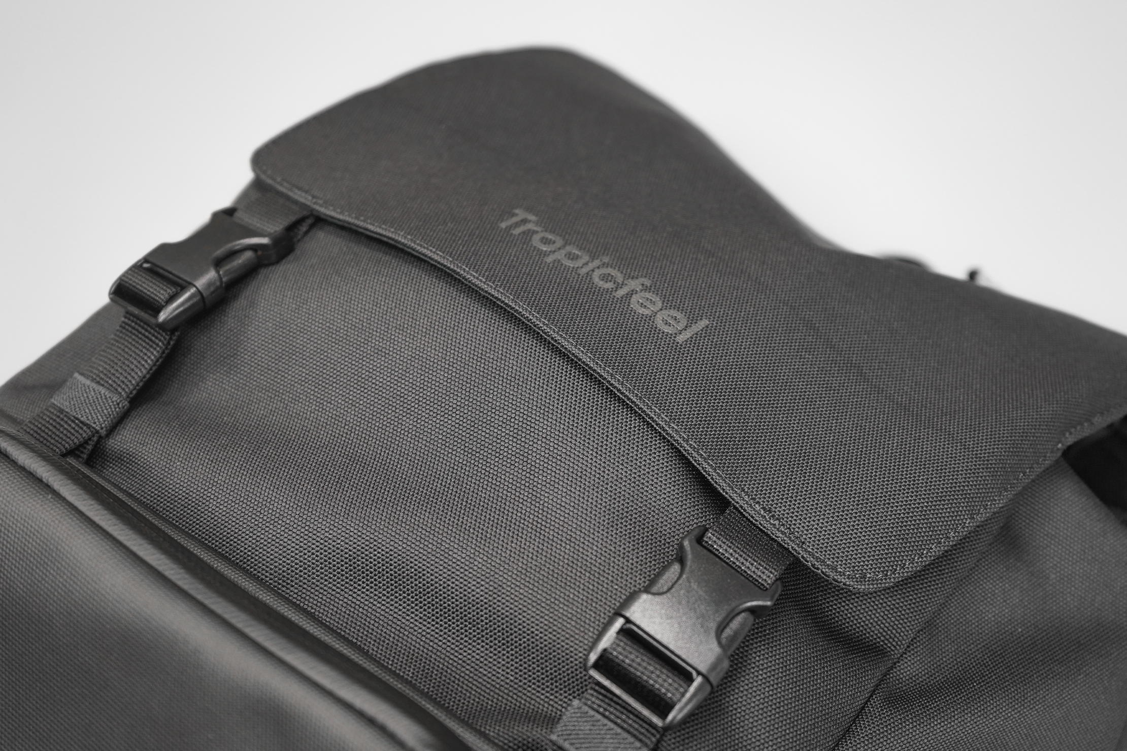 Tropicfeel Shell Travel Backpack | The grey-on-black logo is hardly noticeable