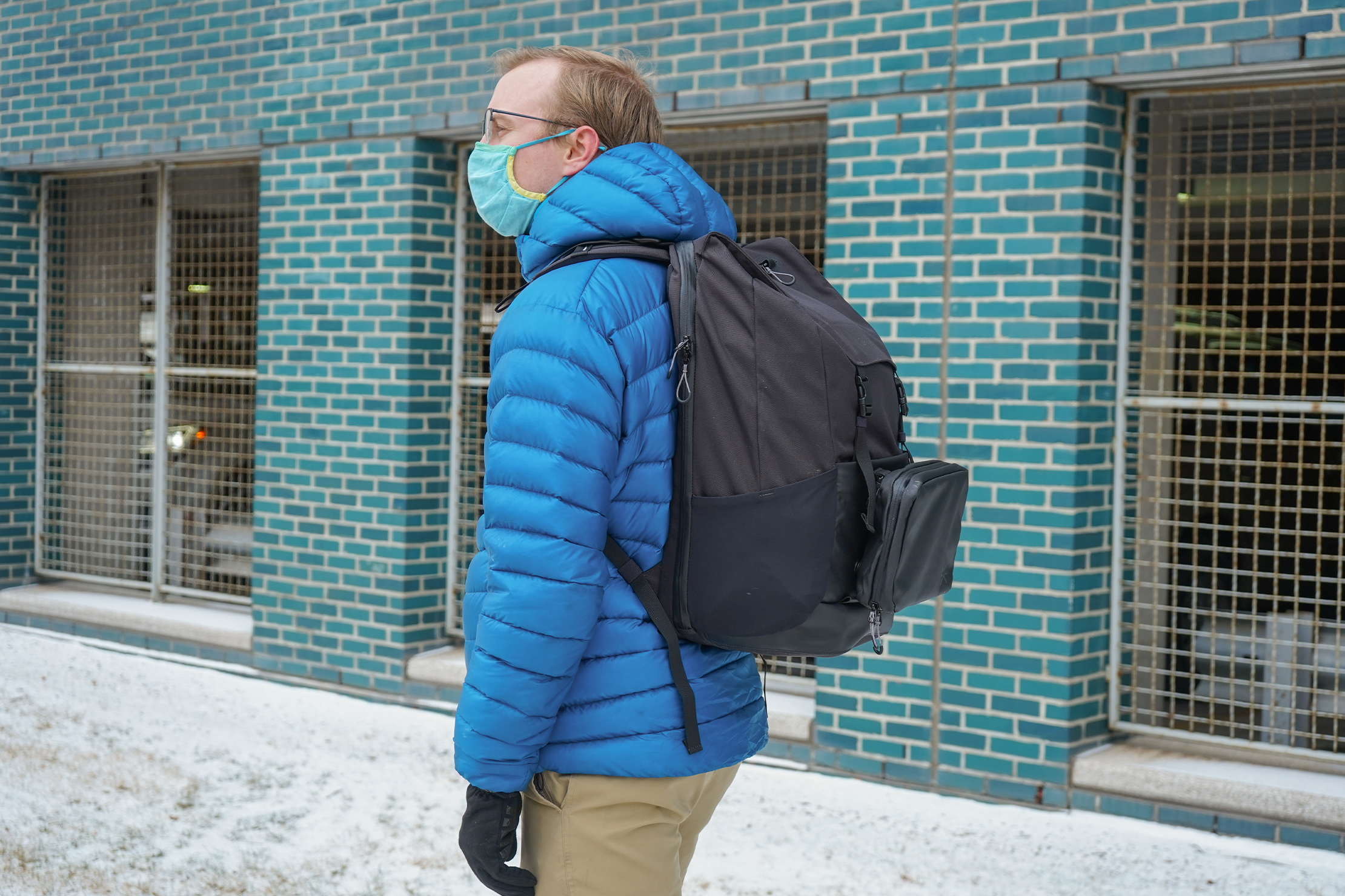 Tropicfeel Shell Travel Backpack | The front pouch sticks out, but it's held secure by magnetic Fidlocks