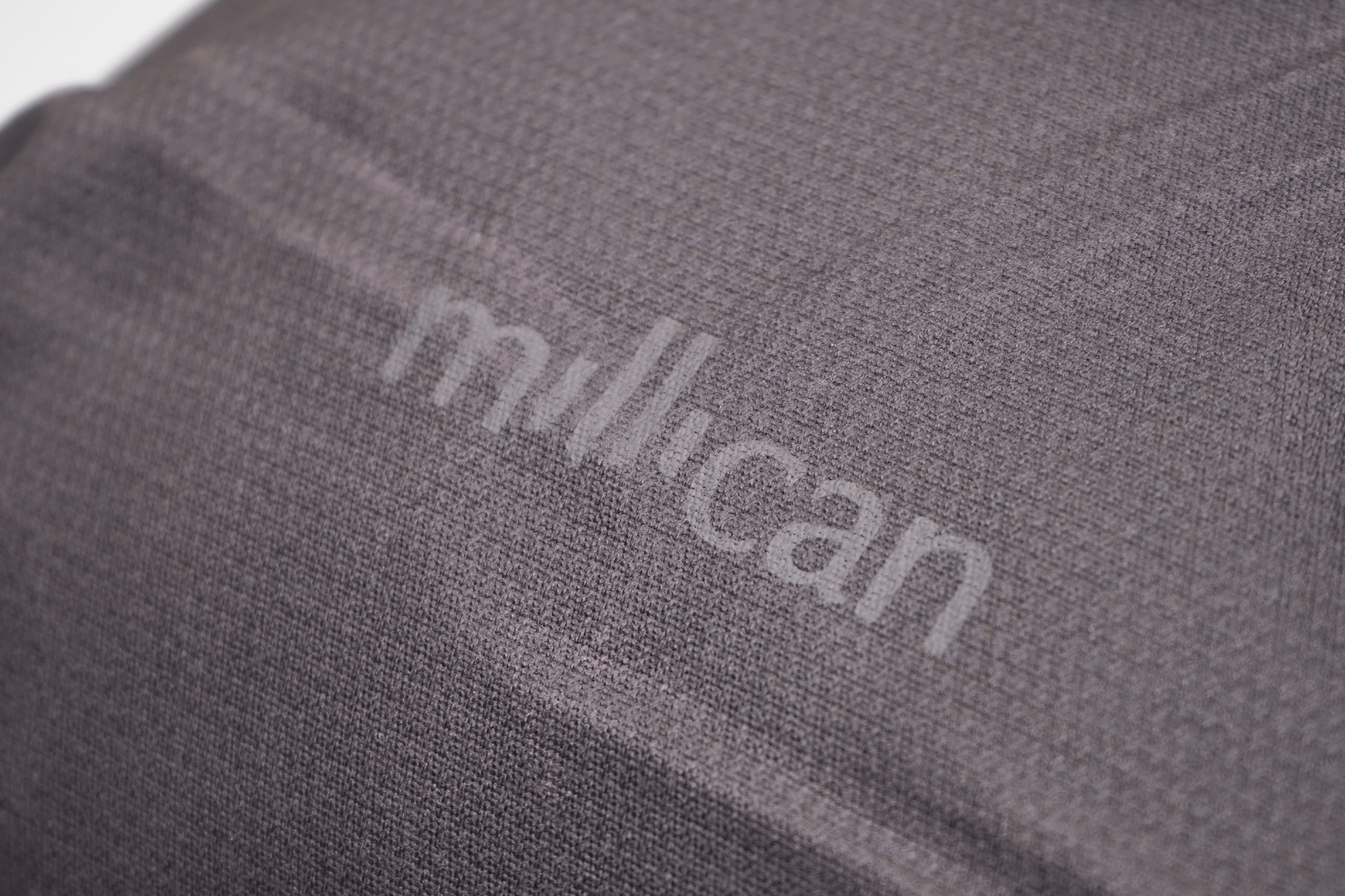 Millican Smith Roll Pack 18L   Subtle branding to keep things minimal