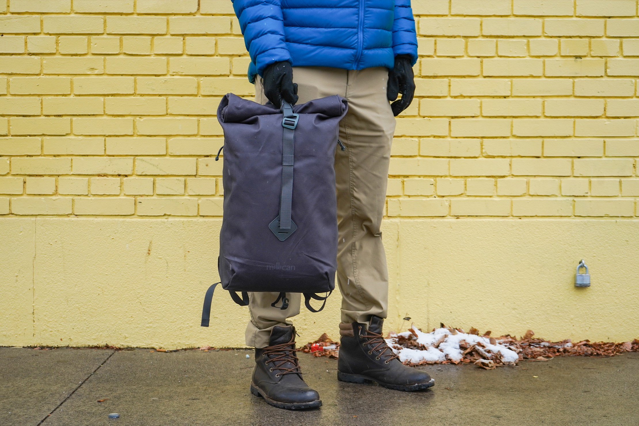 Millican Smith Roll Pack 18L   Single-handed carry using the built-in loop
