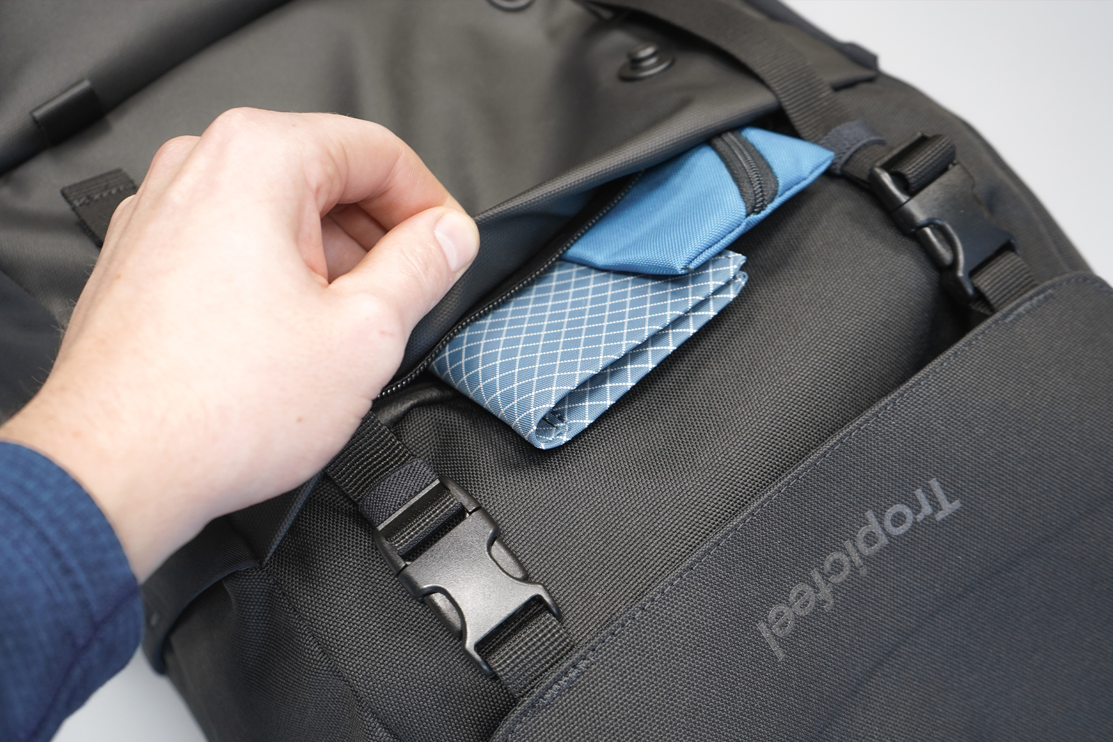 Tropicfeel Shell Travel Backpack | The shrouded front pocket is a nice security feature