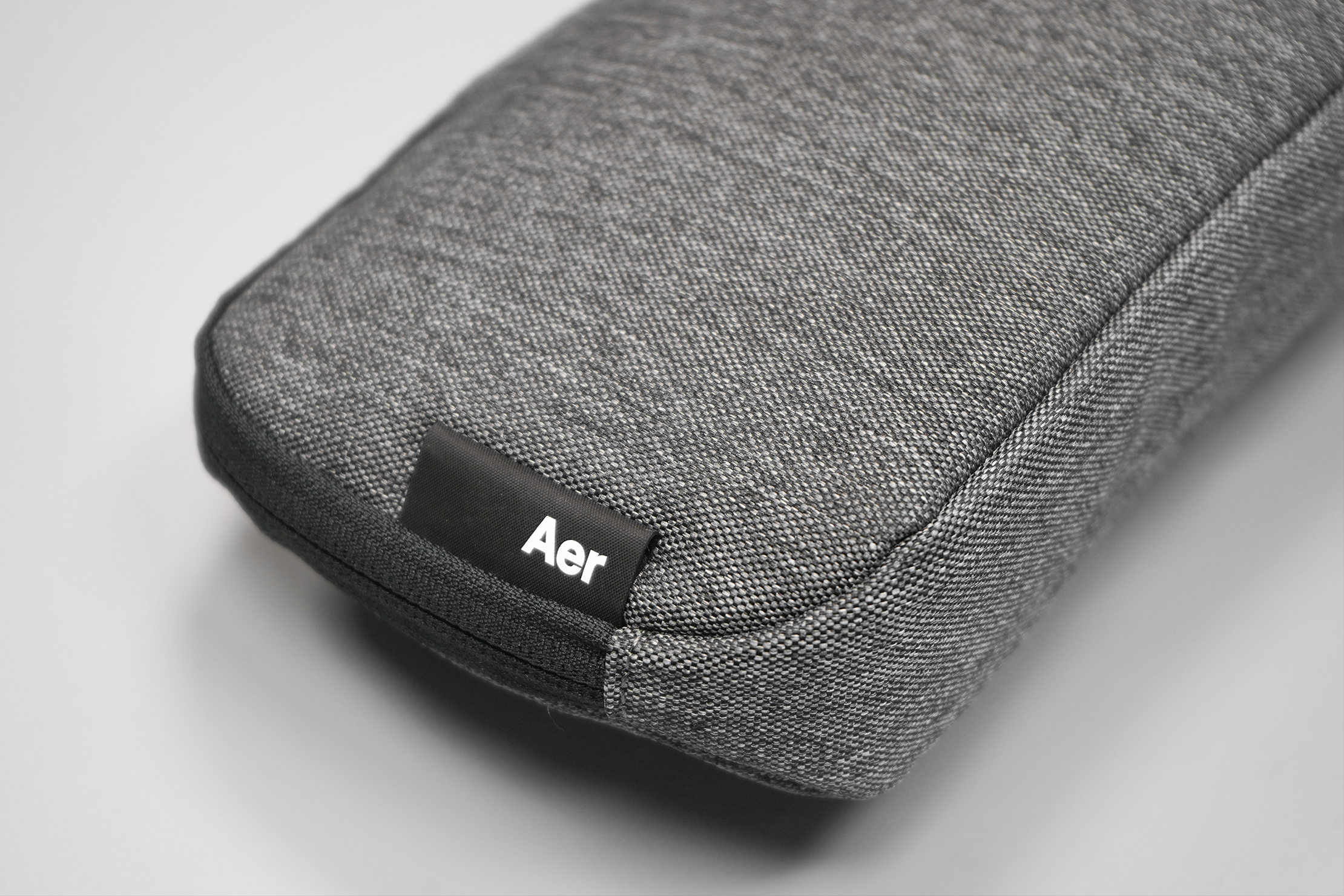 Aer Slim Pouch | This minimalist tag apes Aer's retail store signage