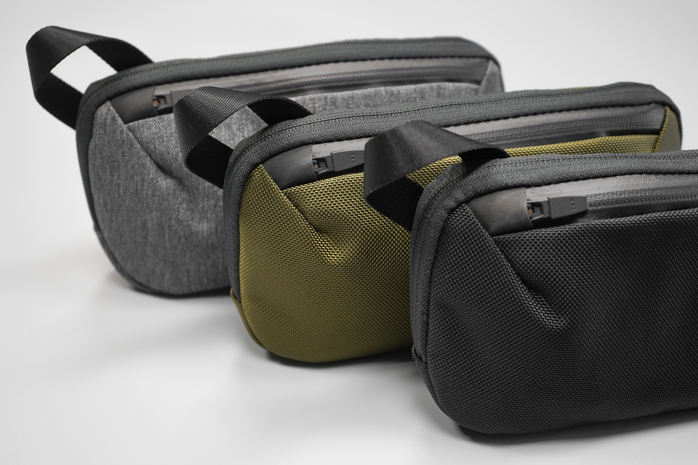 Aer Slim Pouch | From left to right comes Heathered Grey, Olive, and Black