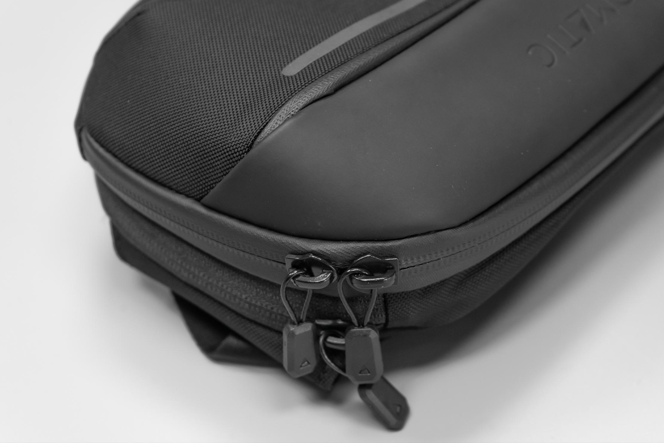 NOMATIC Navigator Sling 1L | Strong choice of materials: Tarpaulin, nylon, and metal wire zipper pulls