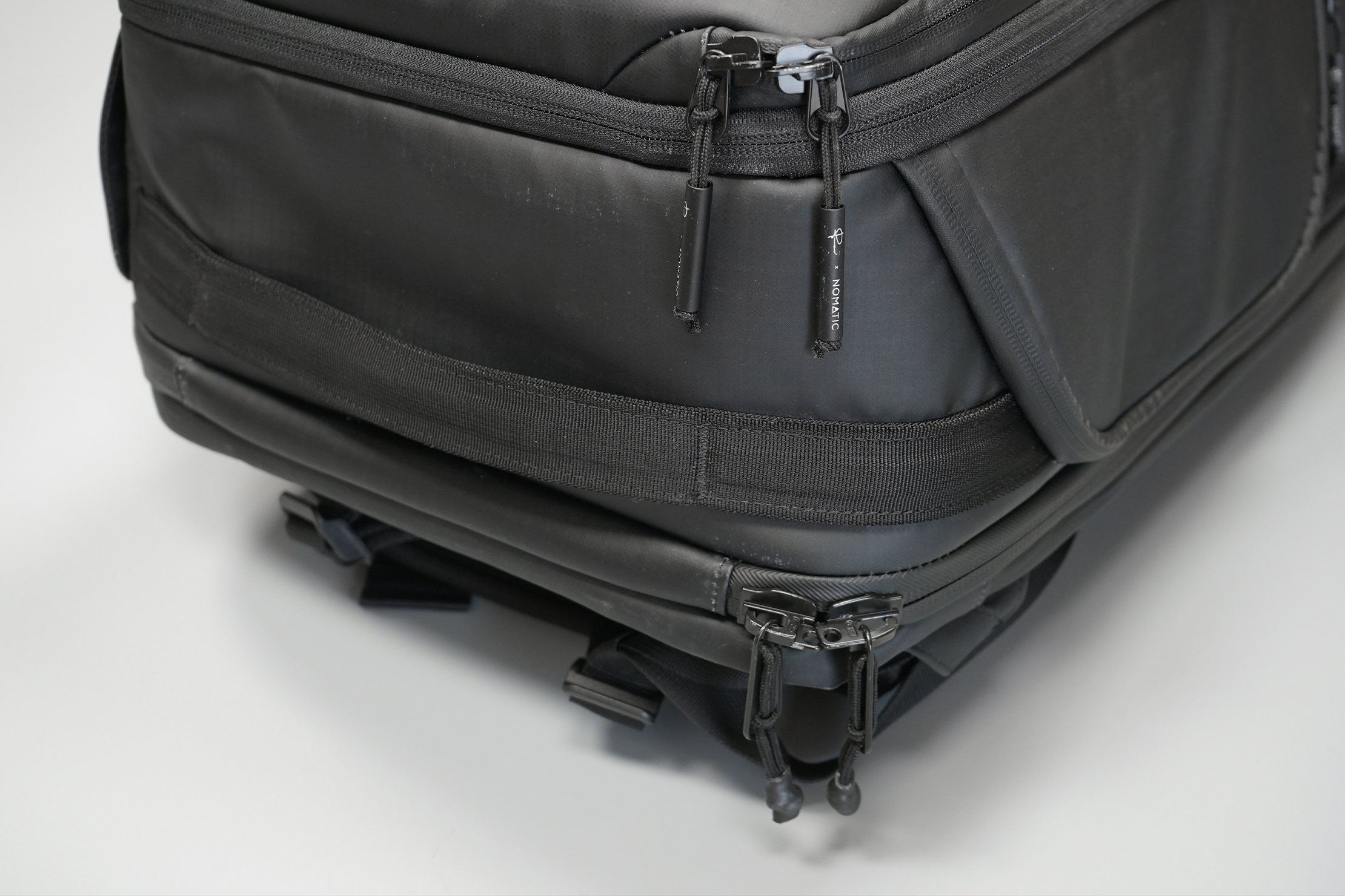 NOMATIC McKinnon Camera Pack 35L | A bottom handle to grab on to in case things go upside-down