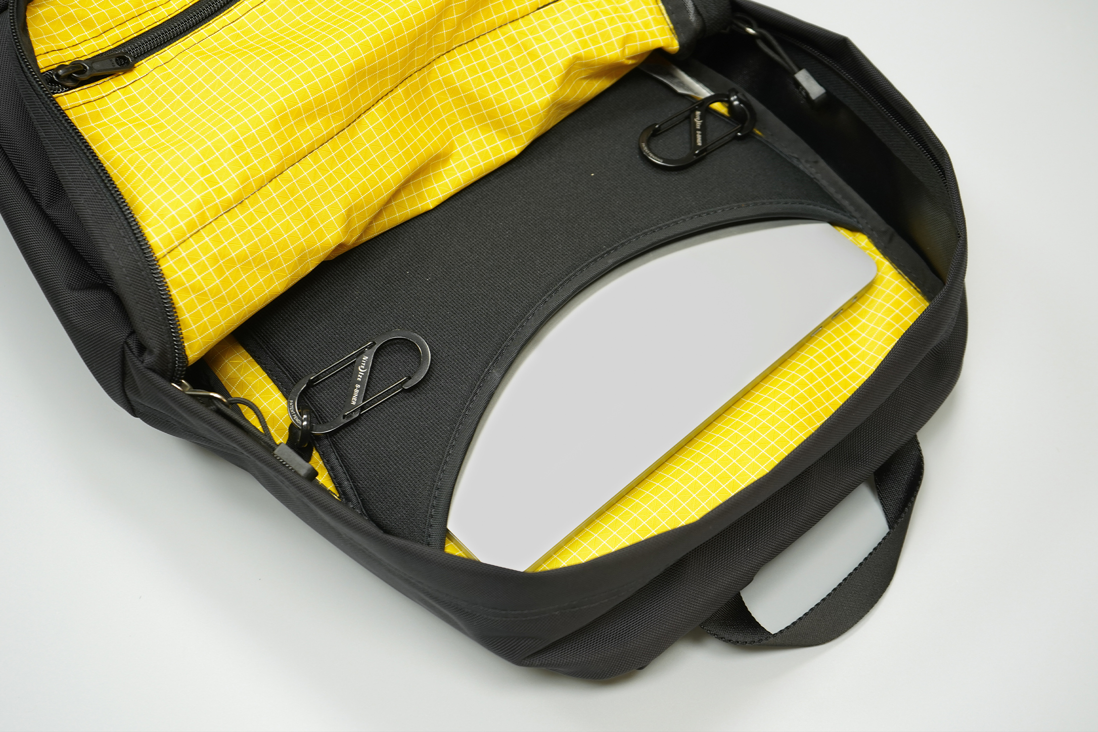 Tom Bihn Paragon Backpack | A well-padded laptop sleeve flanked by O-rings