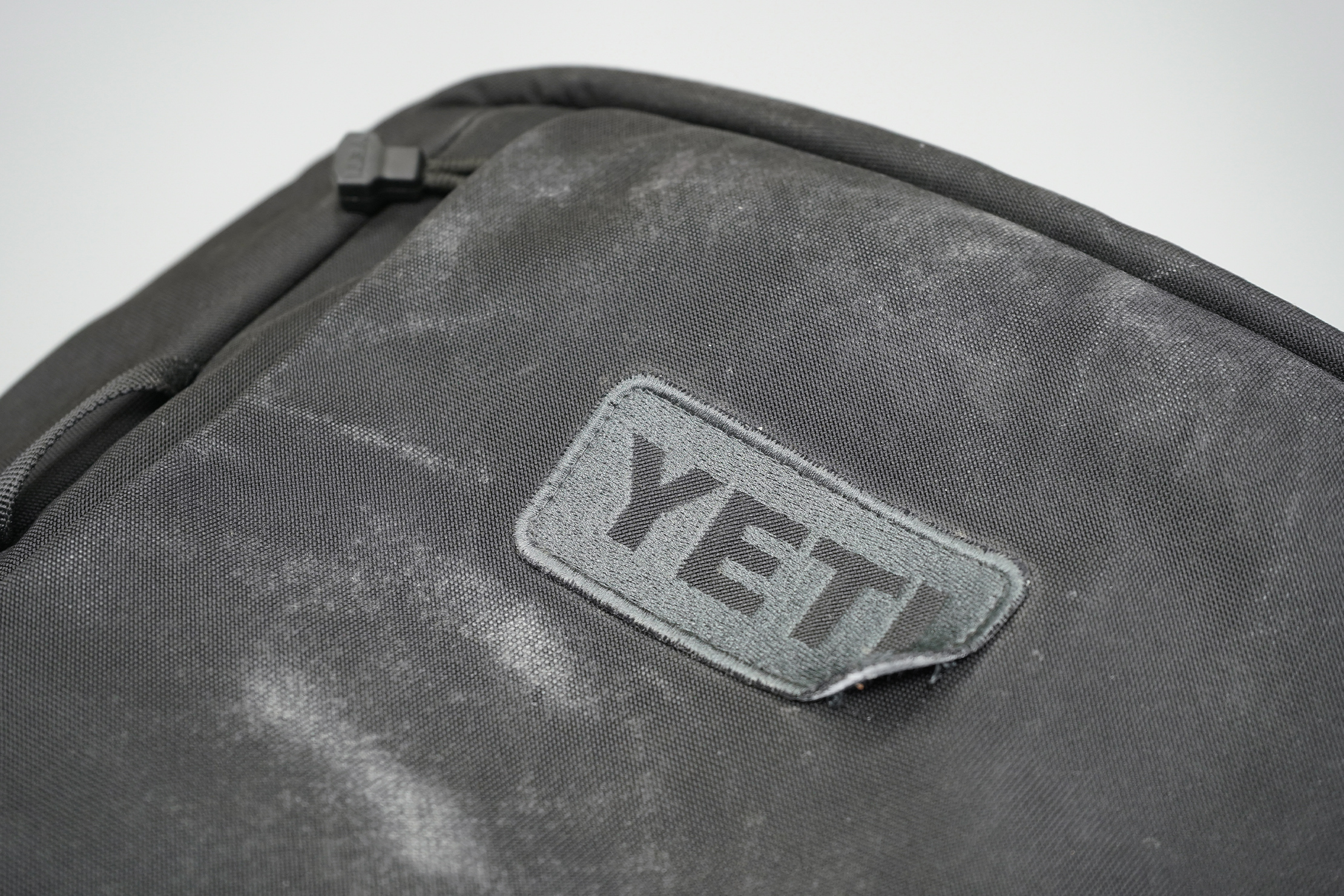 YETI Crossroads 35L Backpack | The logo has started to peel at the corner.