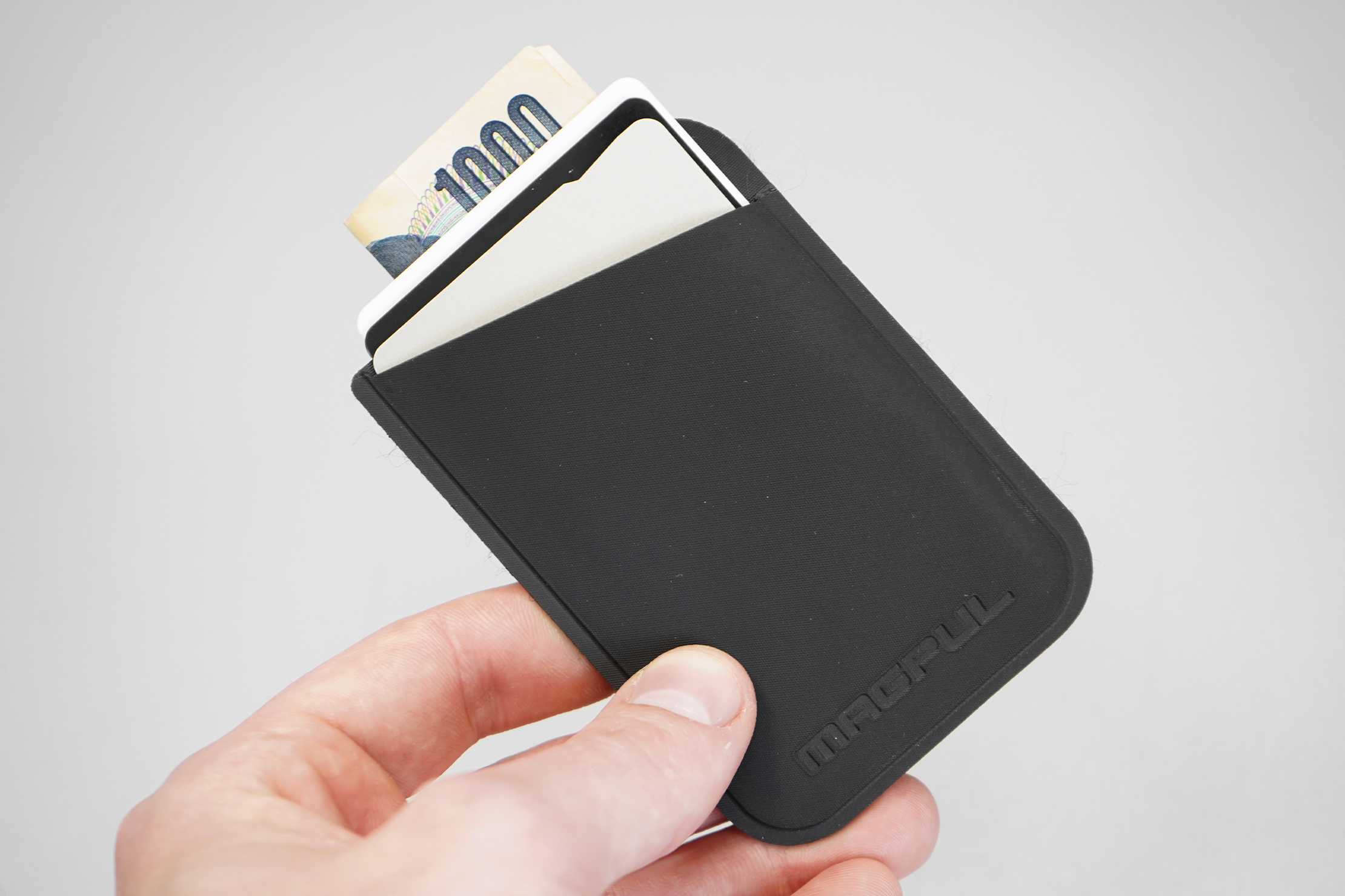 Magpul DAKA Micro Wallet   The ideal loadout: three cards and some cash.