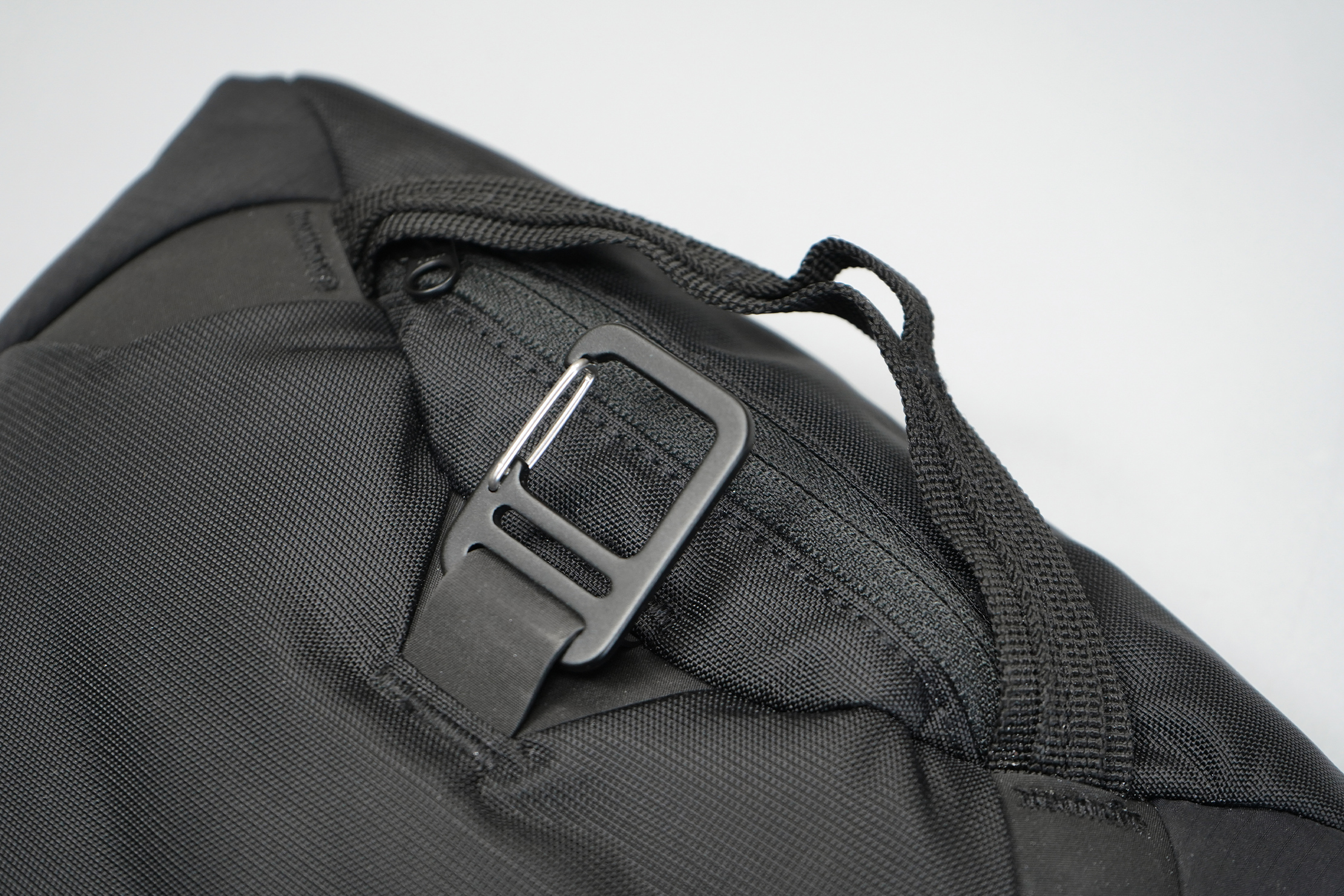 Matador Camera Base Layer 2.0 | There's a top handle and gatekeeper-style clip at the back.