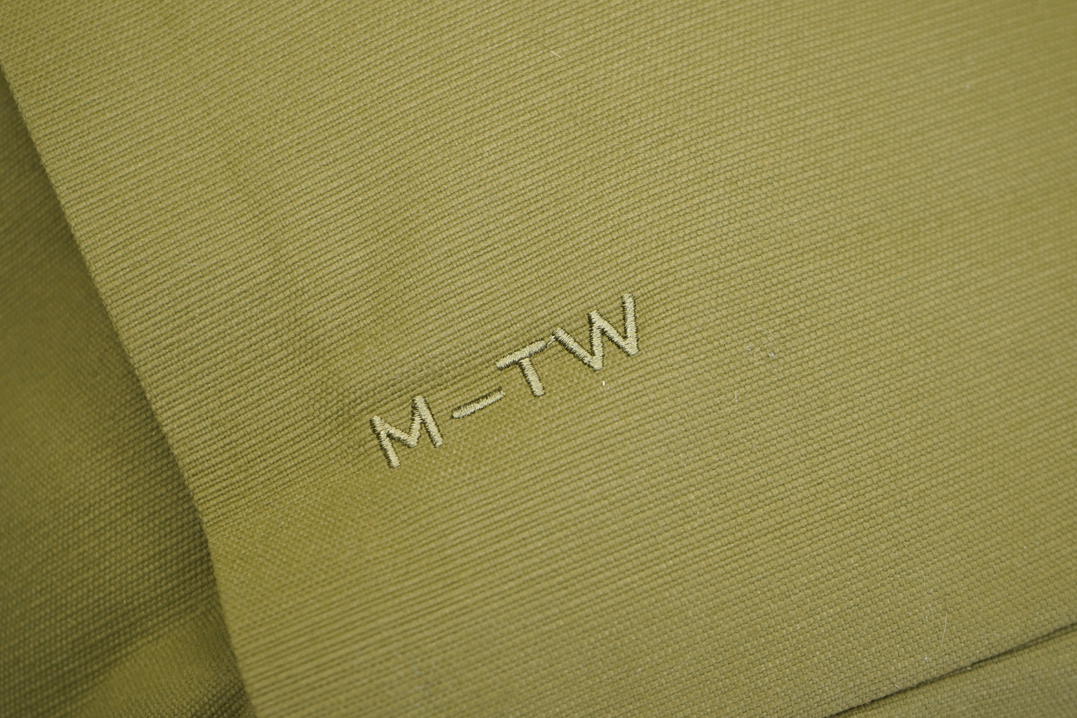 Moment MTW Backpack | Logo and fabric