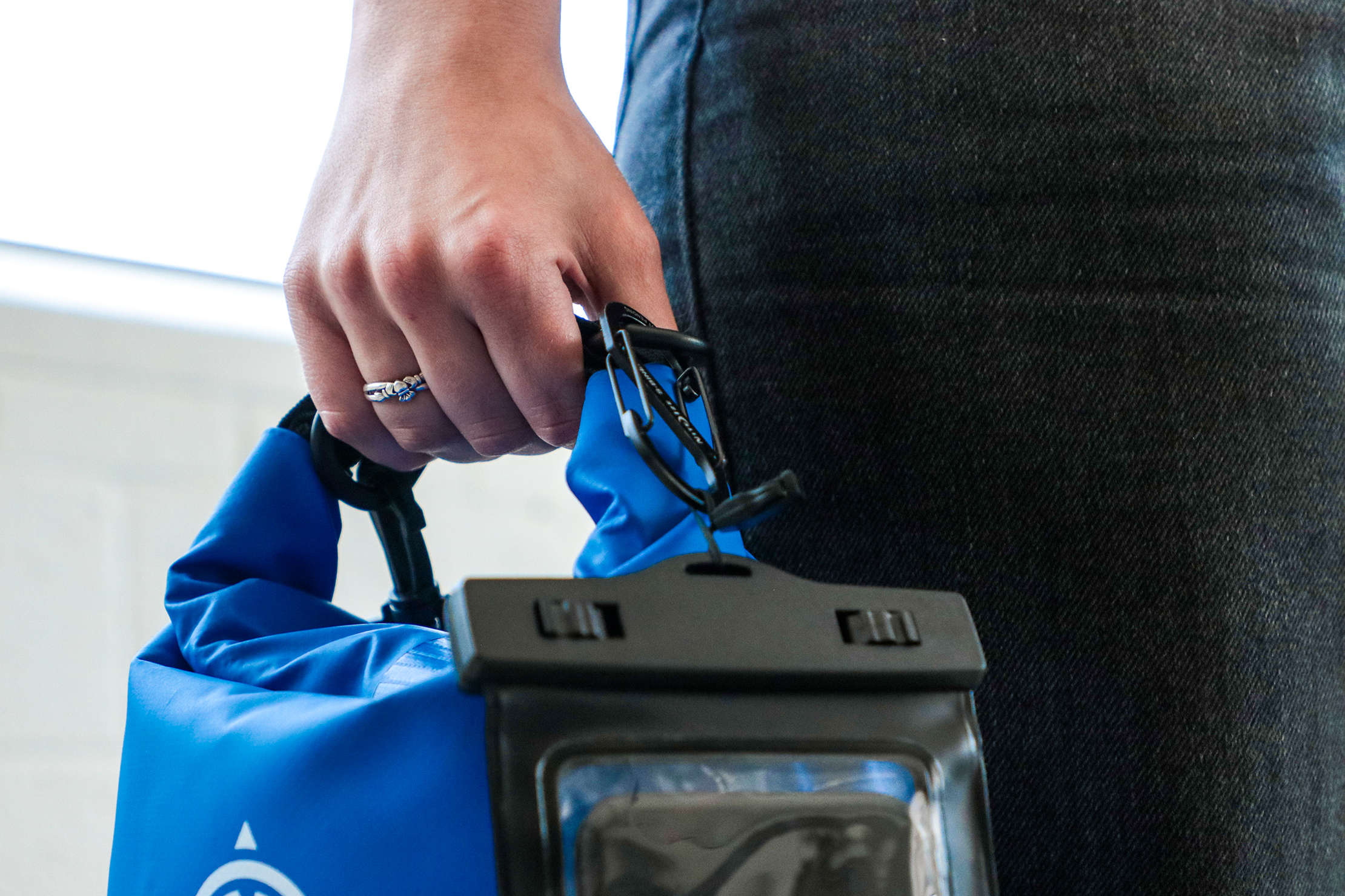 Earth Pak Original Waterproof Dry Bag With Phone In hand