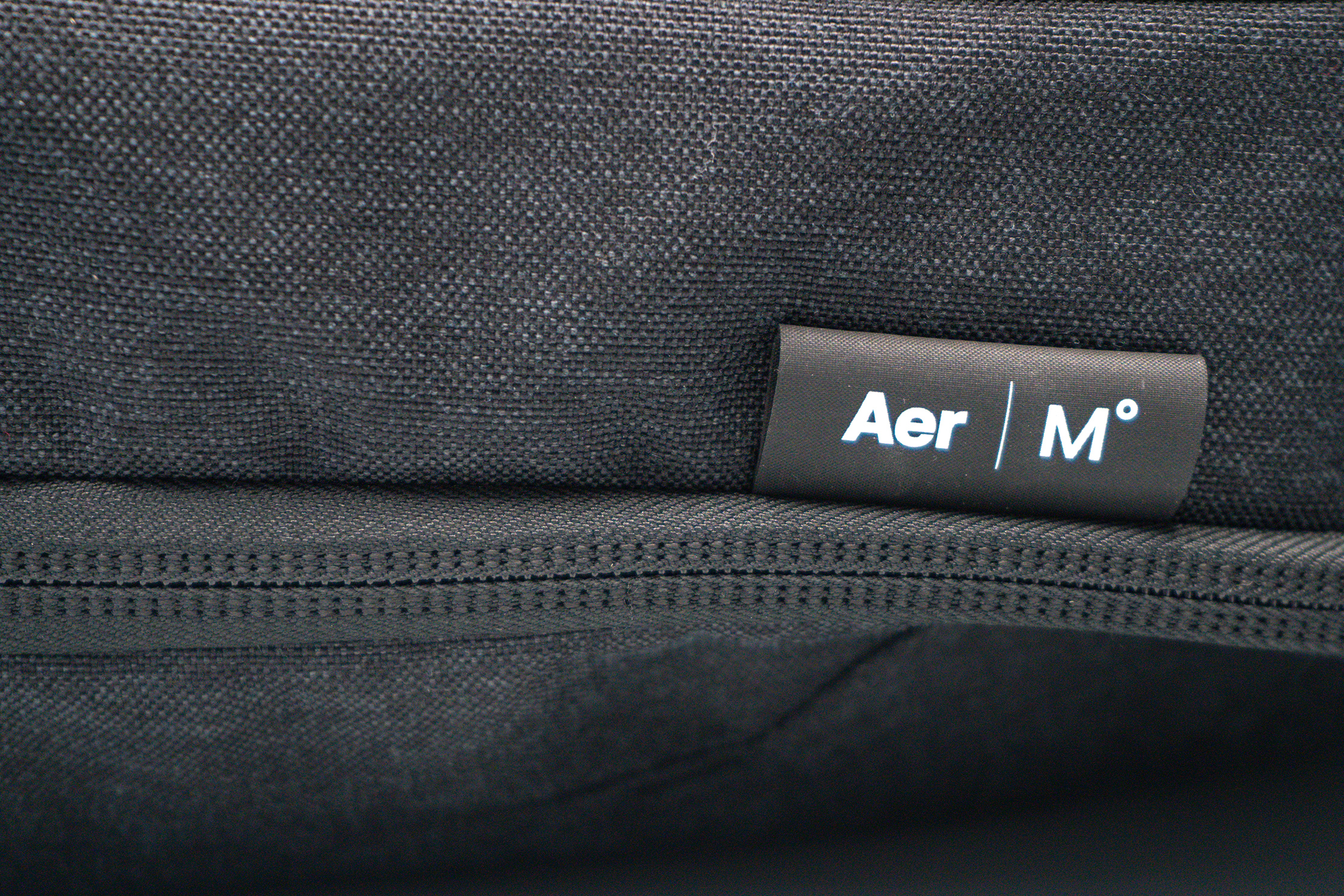 Aer x Ministry of Supply Lunar Pack Logo and Material