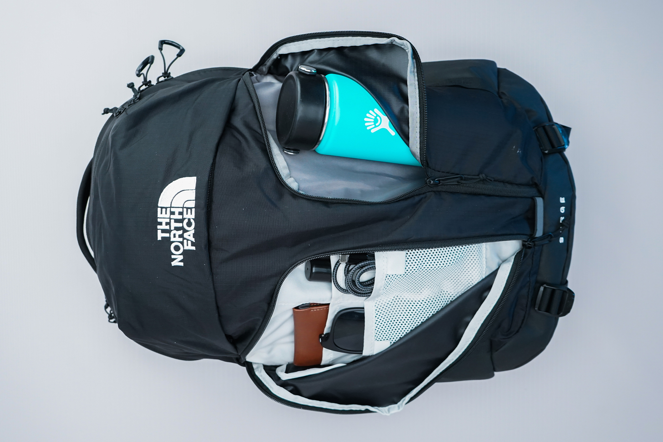 The North Face Surge Backpack front vertical pockets