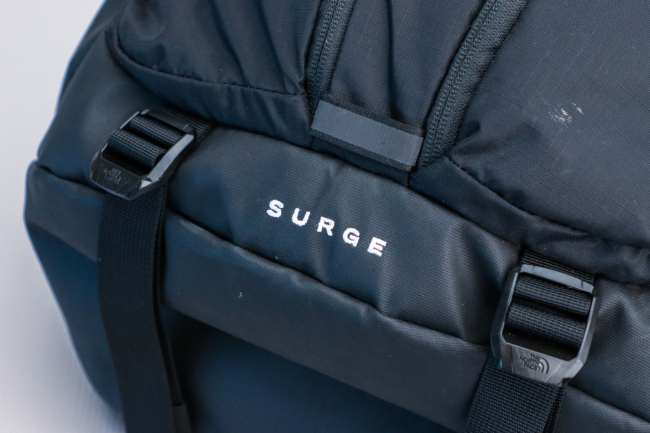 The North Face Surge Backpack logo