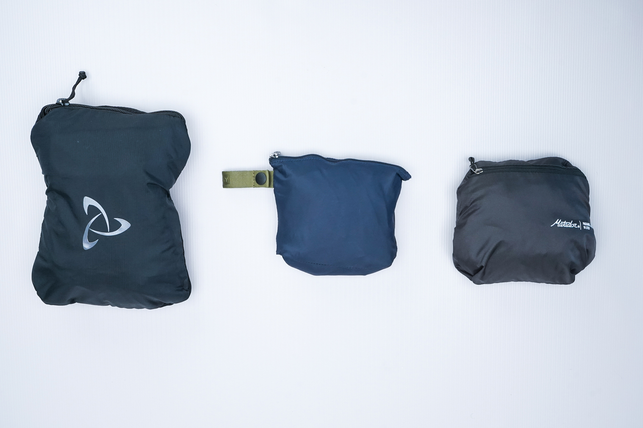 Away Packable Backpack Top Comparison