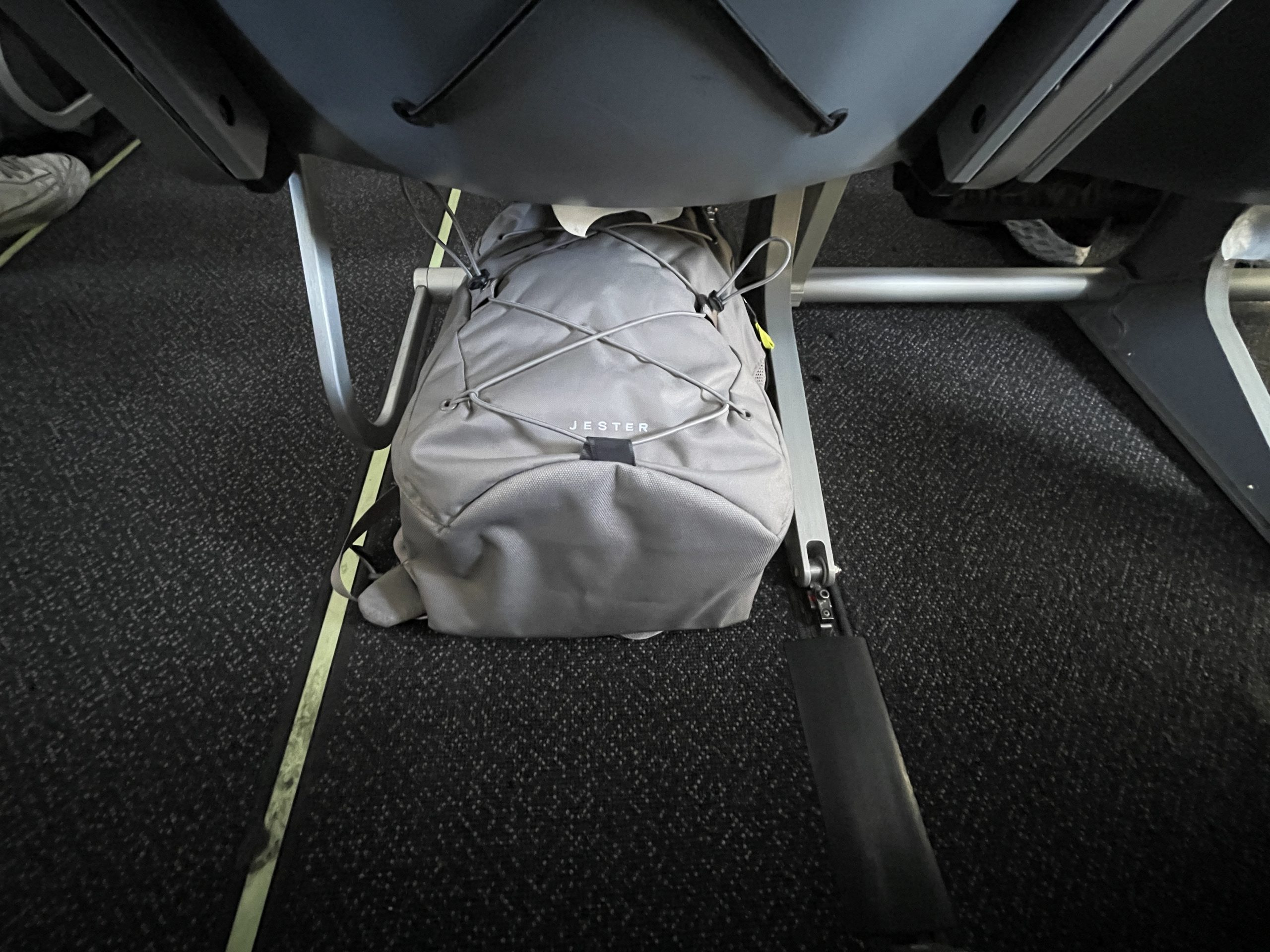 The North Face Jester under the airplane seat